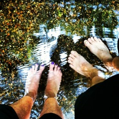 our feet in the stream